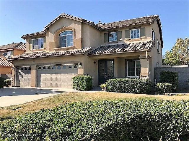 Single Family Homes por un Venta en 15260 McDonnell Avenue Fontana, California 92336 Estados Unidos