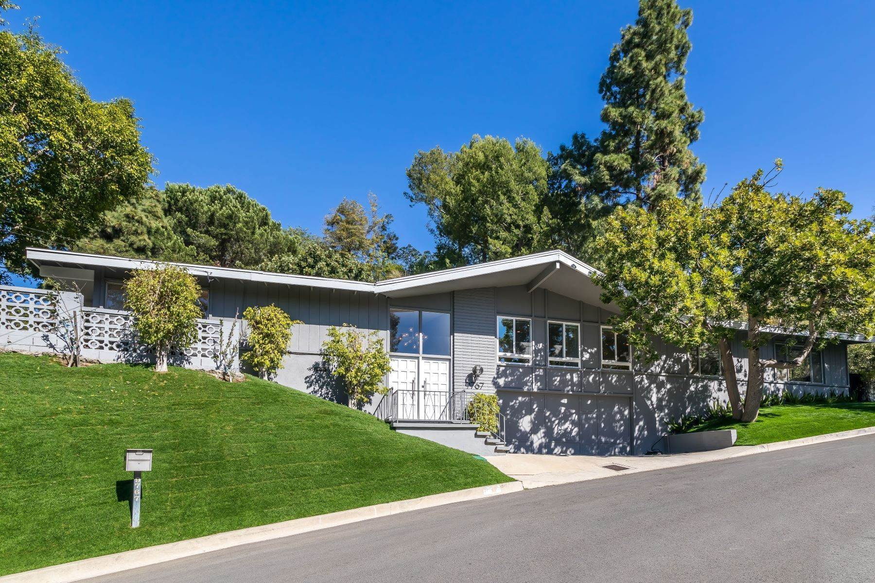 Single Family Homes for Sale at Mid Century Modern Single Story Home 9767 Beth Place Beverly Hills, California 90210 United States